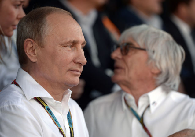 File photo: Russian President Vladimir Putin and Formula One boss Bernie Ecclestone during the Russian stage of the Formula 1 World Championship race in Sochi on 12 October, 2014