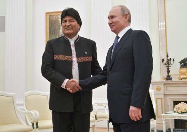 Bolivian President Evo Morales, left, and Russian President Vladimir Putin shake hands during their meeting at Moscow's Kremlin, Russia. Morales is on official visit to Russia