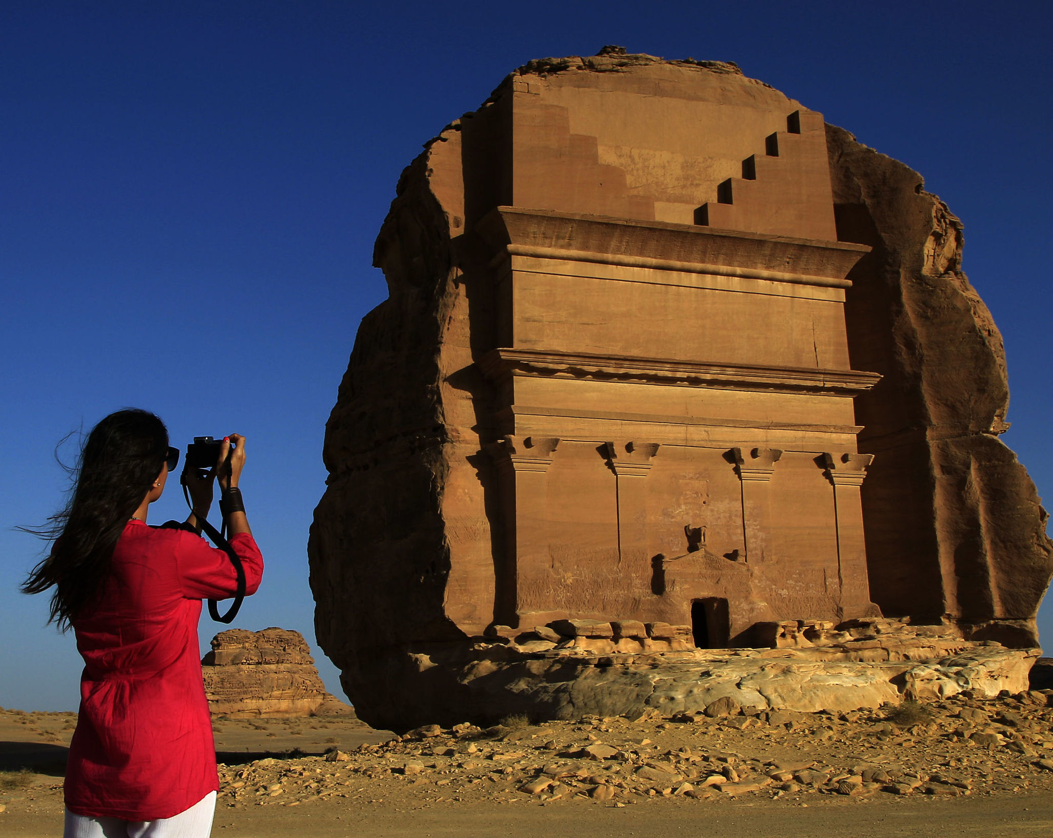 In this photograph made on Thursday, May 10, 2012, a foreign tourist visits the Abu Lawha, the largest Nabataean tomb at the desert archaeological site of Madain Saleh, in Al Ula city, 1043 km (648 miles) northwest of the capital Riyadh, Saudi Arabia