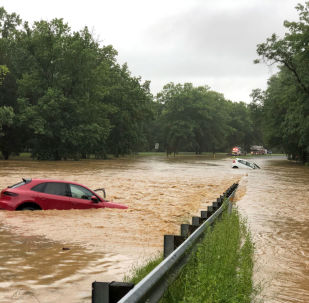 Cars are seen in flood waters on Clara Barton Parkway near Washington, U.S., July 8, 2019 in this picture obtained from social media