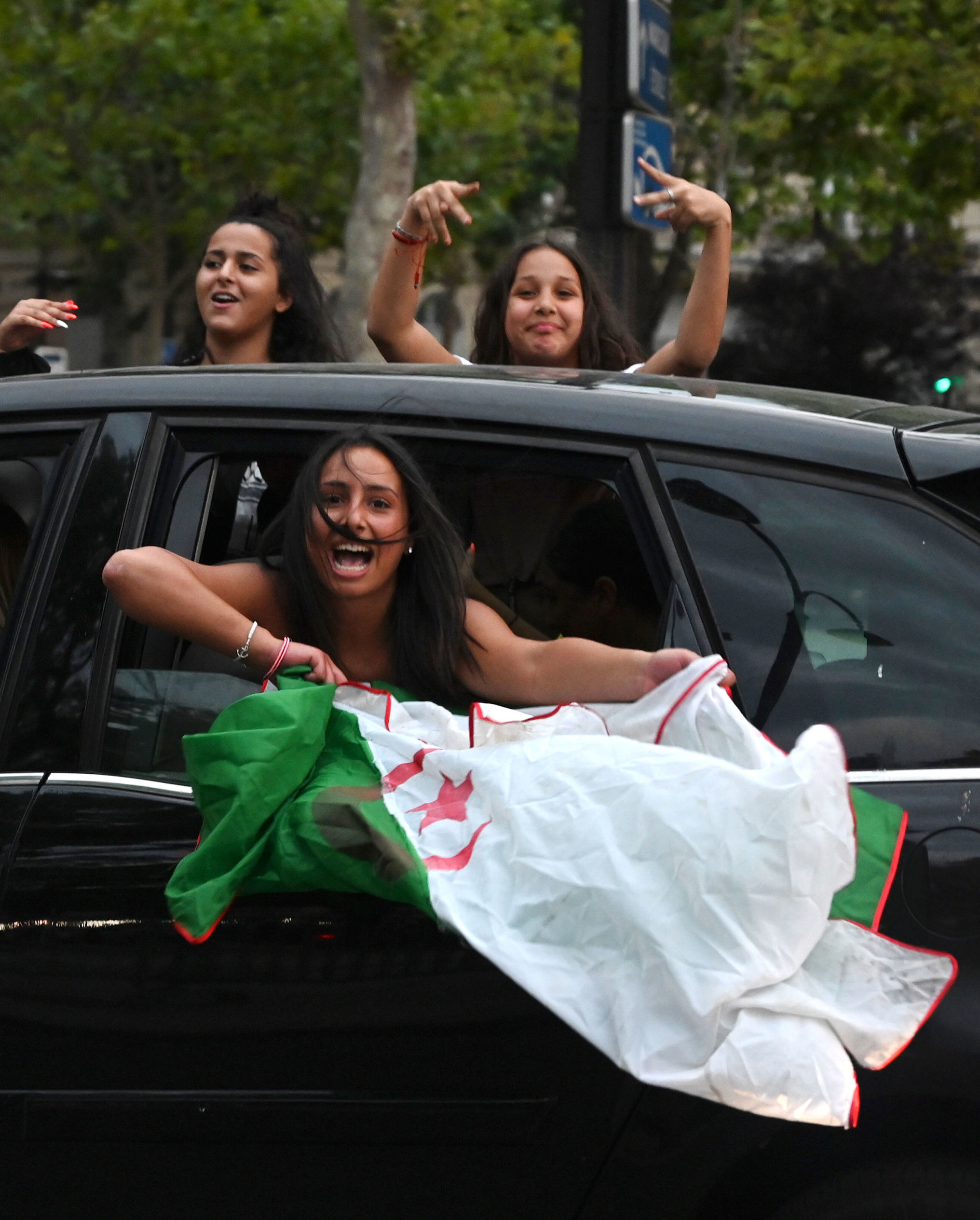 Algerian supporters celebrate in Paris after the victory of their team during the 2019 Africa Cup of Nations (CAN) quarter final football match between Ivory Coast and Algeria, on July 11, 2019