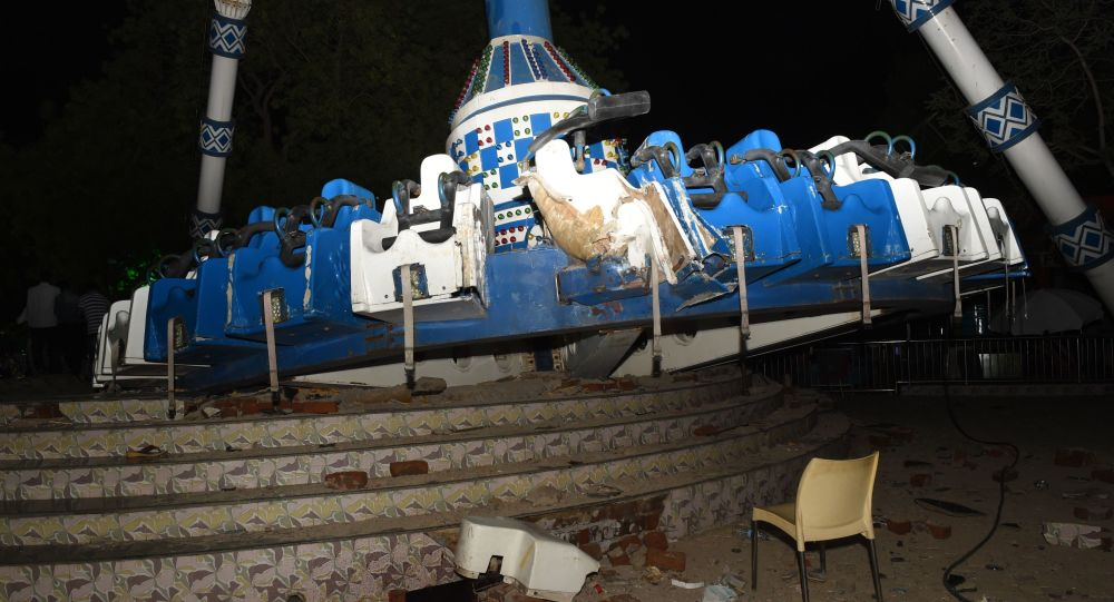 Indian amusement park ride snaps in half, killing two and injuring 27