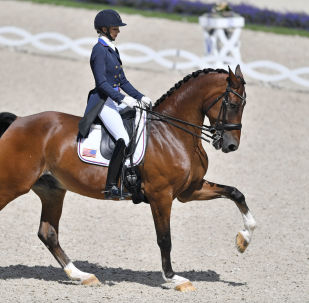 Laura Graves of the USA performs on Verdades at the Grand Prix Freestyle Dressage CDIO at the CHIO Equestrian Festival in Aachen, Germany, Sunday, July 23, 2017