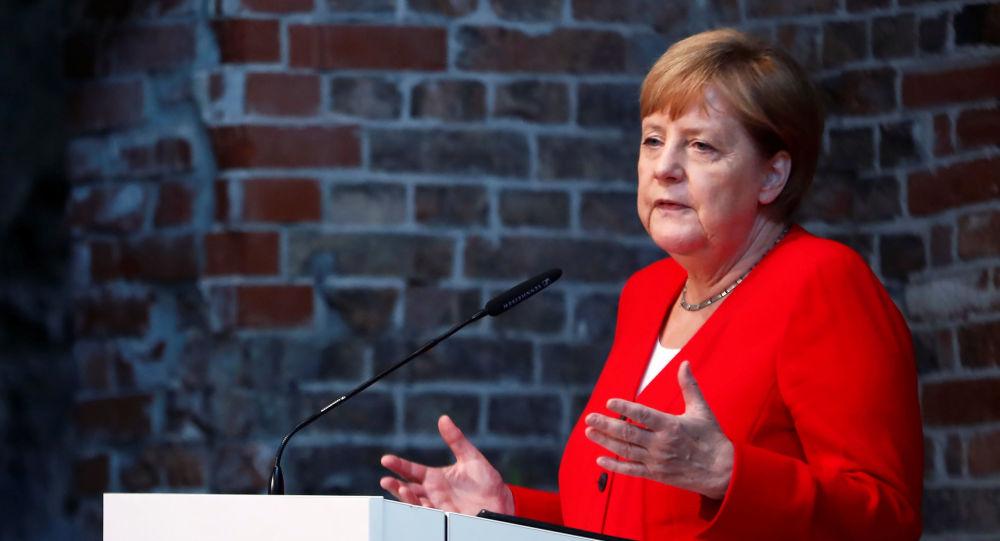 German Chancellor Angela Merkel speaks during a ceremony to mark 50 years of German development aid in Berlin, Germany, July 12, 2019