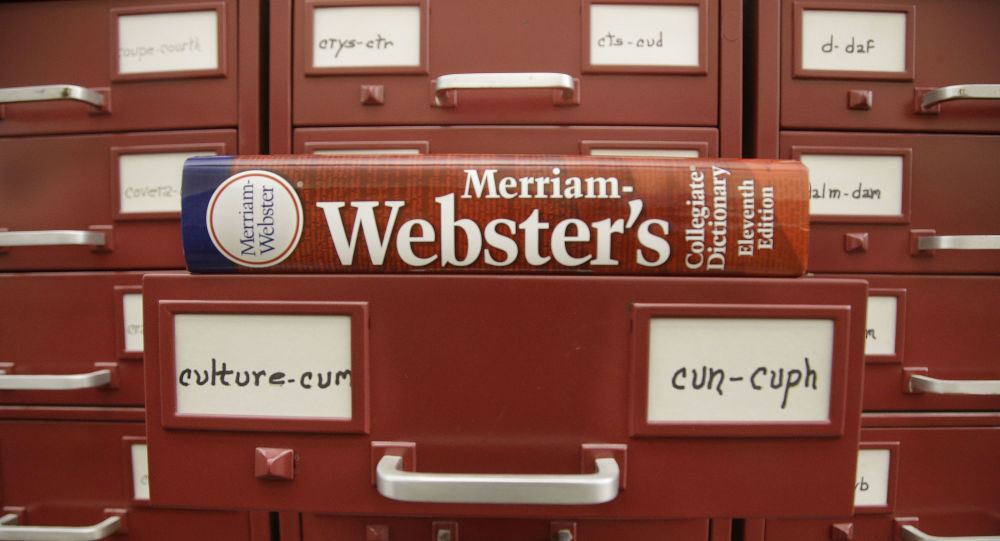 In this Tuesday, Dec. 9, 2014 photo, a Merriam-Webster dictionary sits atop their citation files for the 2014 word of the year, culture, at the dictionary publisher's offices in Springfield, Mass.