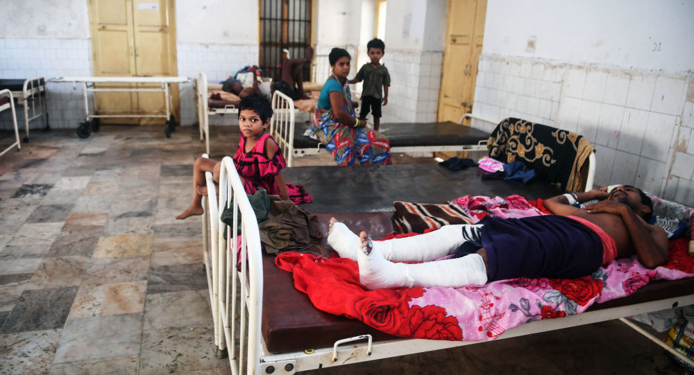 People injured when Cyclone Fani swept through India's eastern Odisha state rest at the district hospital in Puri on May 5, 2019