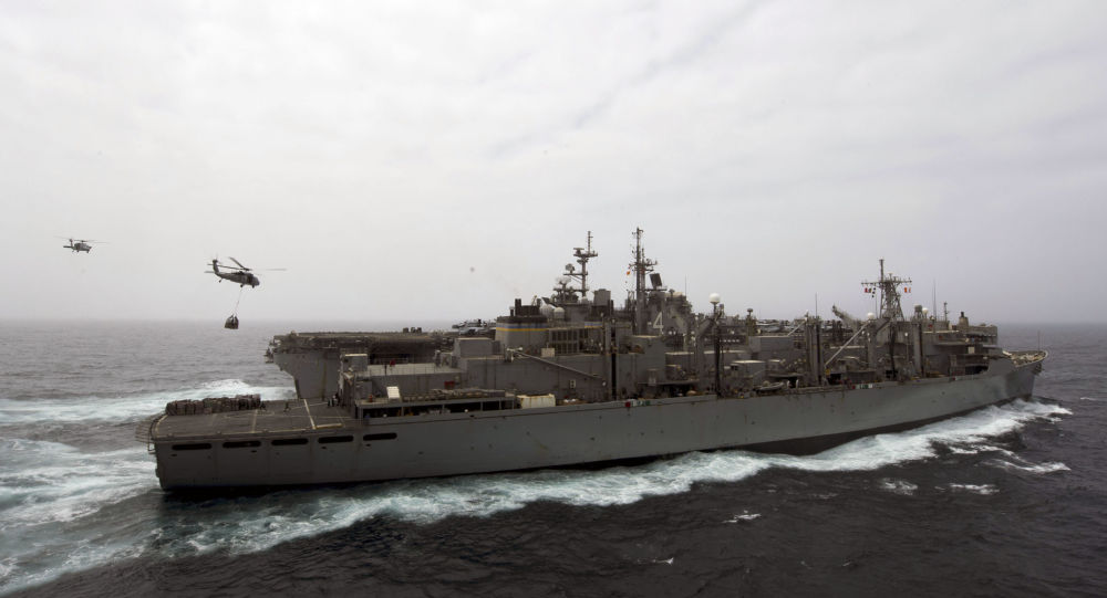 This US Navy photo obtained July 18, 2019 shows the amphibious assault ship USS Boxer (LHD 4), background, as it receives a vertical replenishment-at-sea from the fast combat support ship USNS Arctic (T-AOE 8) on July 14, 2019 in the Gulf.