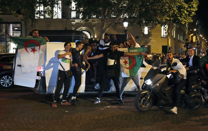 Football Fans Celebrating Algerian Soccer Team Win Knock Down de Gaulle Statue in France - Report