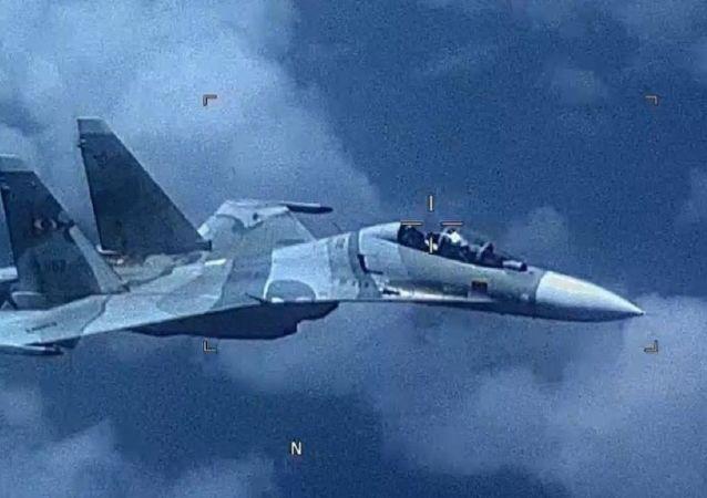 Venezuela SU-30 Flanker Shadows a U.S. EP-3 Aircraft