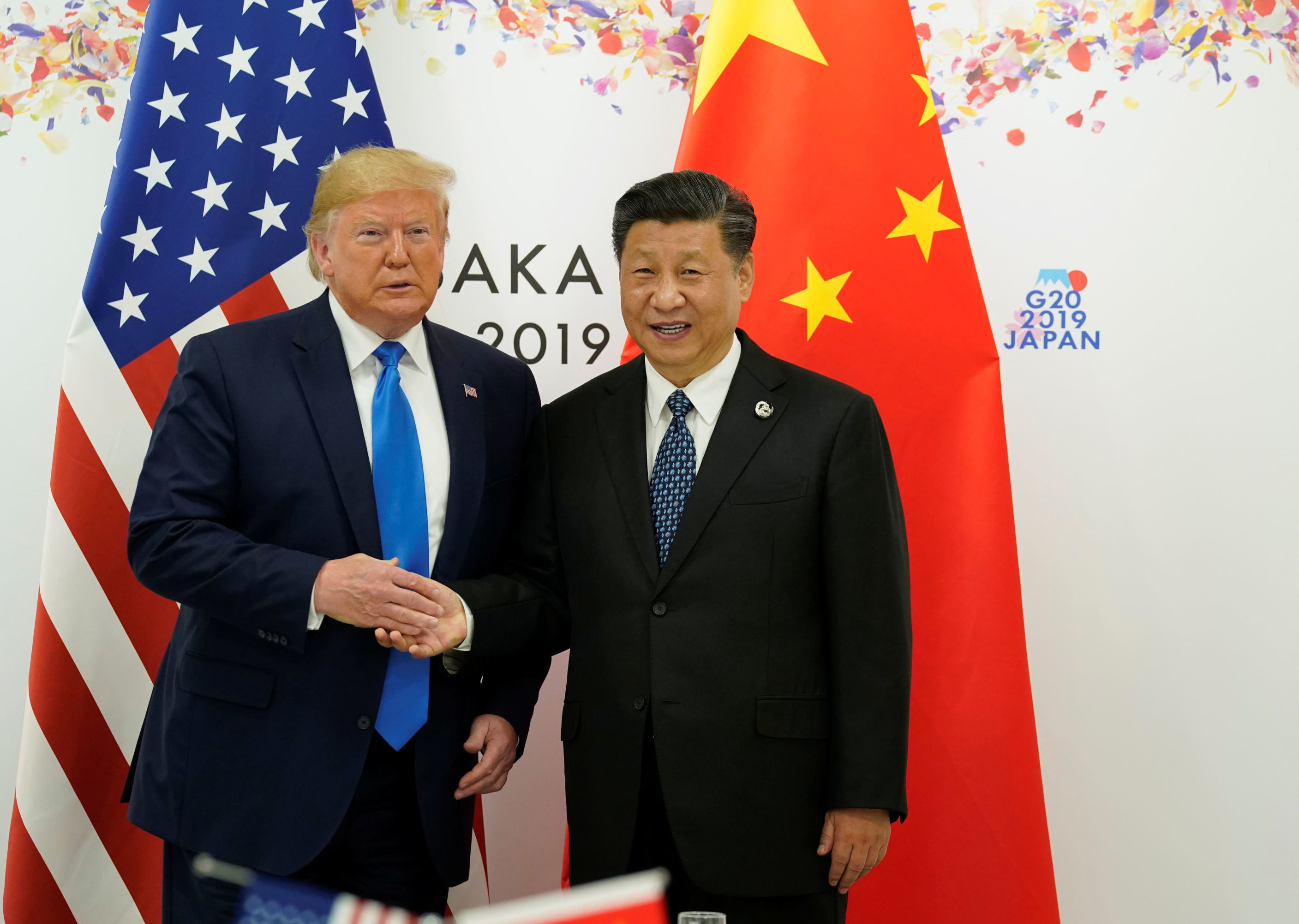 U.S. President Donald Trump and China's President Xi Jinping pose for a photo ahead of their bilateral meeting during the G20 leaders summit in Osaka, Japan, June 29, 2019