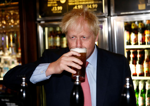 Boris Johnson, a leadership candidate for Britain's Conservative Party, drinks a beer at Wetherspoons Metropolitan Bar in London, Britain, July 10, 2019