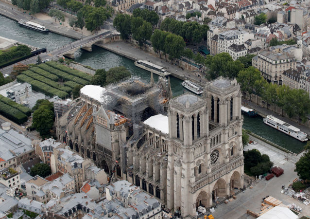 Parts of a destroyed ribbed vault and scaffolding are seen during preliminary work in the Notre-Dame Cathedral, three months after a major fire, in Paris