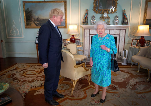 Queen Elizabeth II speaks to Boris Johnson during an audience in Buckingham Palace, where she will officially recognise him as the new Prime Minister, in London