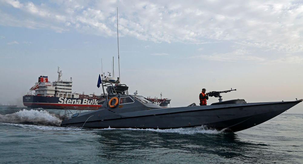 A boat of the Iranian Revolutionary Guard sails next to Stena Impero, a British-flagged vessel owned by Stena Bulk, at Bandar Abbas port, July 21, 2019.