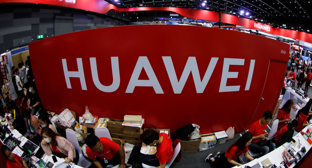 Workers sit at the Huawei stand at the Mobile Expo in Bangkok, Thailand May 31, 2019