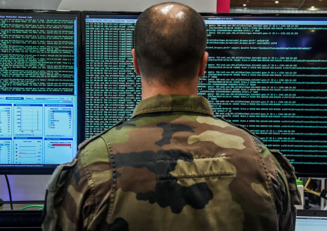 A member of the military specialised in cyber defense works on servers (File)
