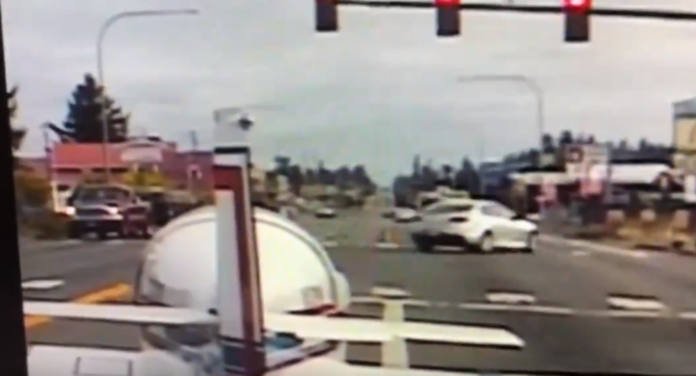 Incredible dashcam video shows moment plane lands on busy roadway