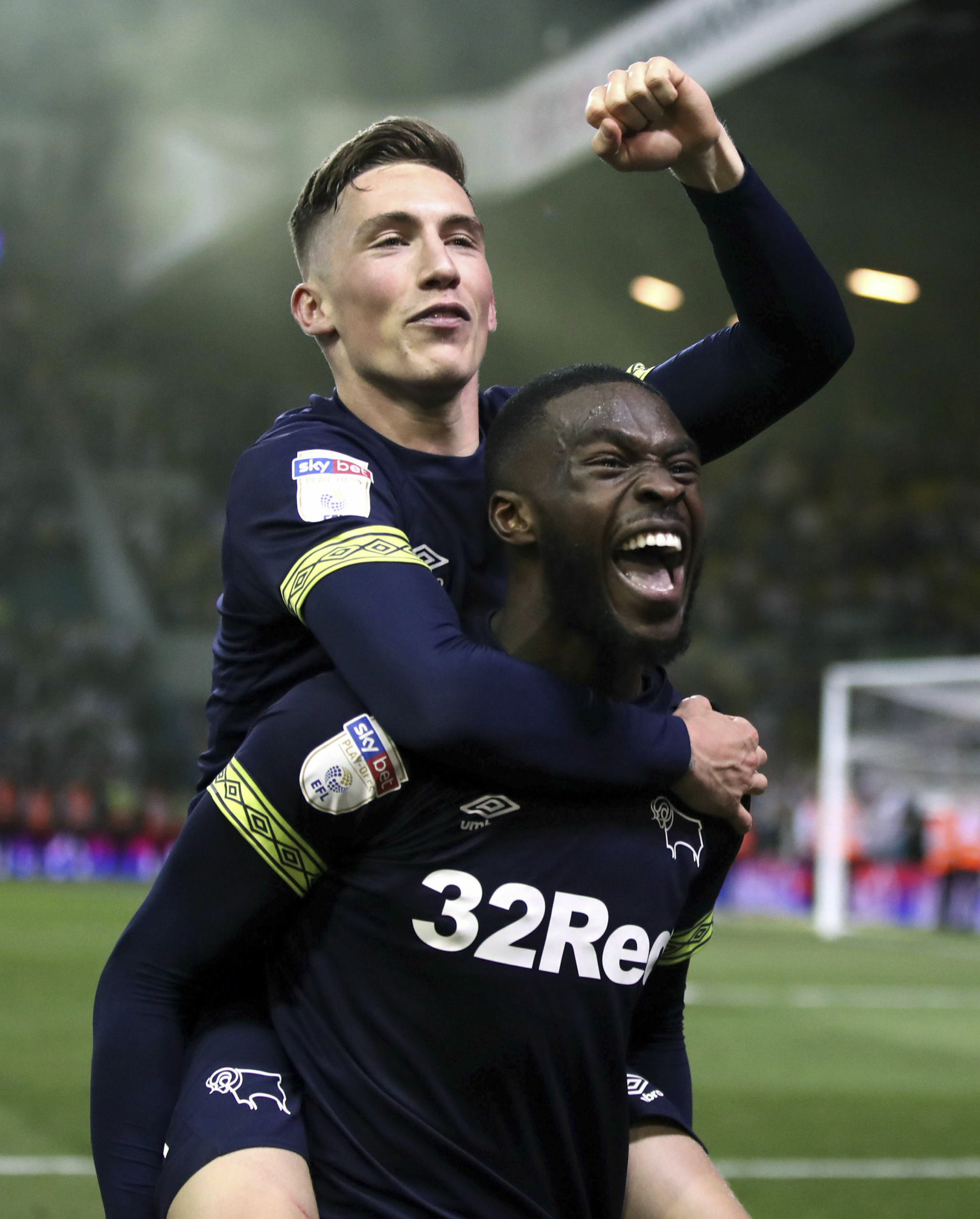 Derby County's Harry Wilson, left, and Fikayo Tomori celebrate victory after the English Championship Play-Off, Semi Final, Second Leg soccer match against Leeds United at Elland Road, Leeds, England, Wednesday May 15, 2019