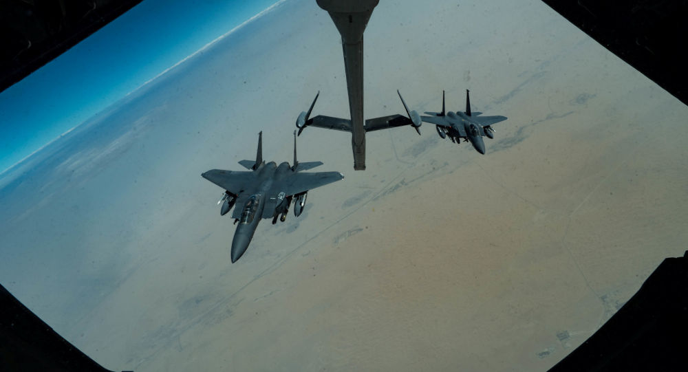 F-15E Strike Eagles assigned to the 336th Expeditionary Fighter Squadron approaches a KC-10 Extender for refuelling, at an undisclosed location in Gulf, during a surface combat air patrol mission, in this undated handout picture released by U.S. Air Force on June 27, 2019