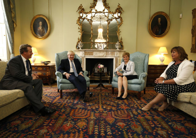 Britain's Scotland Secretary Alister Jack (L), Britain's Prime Minister Boris Johnson (2nd L), Scotland's First Minister Nicola Sturgeon (2nd R) and SNP (Scottish National Party) Cabinet Secretary for Culture, Tourism and External Affairs, Fiona Hyslop (R) pose for a photograph before talks at Bute House in Edinburgh during his visit to Scotland on July 29, 2019.