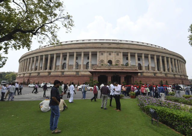 Visitors are seen at the Parliament House in New Delhi on August 5, 2019.
