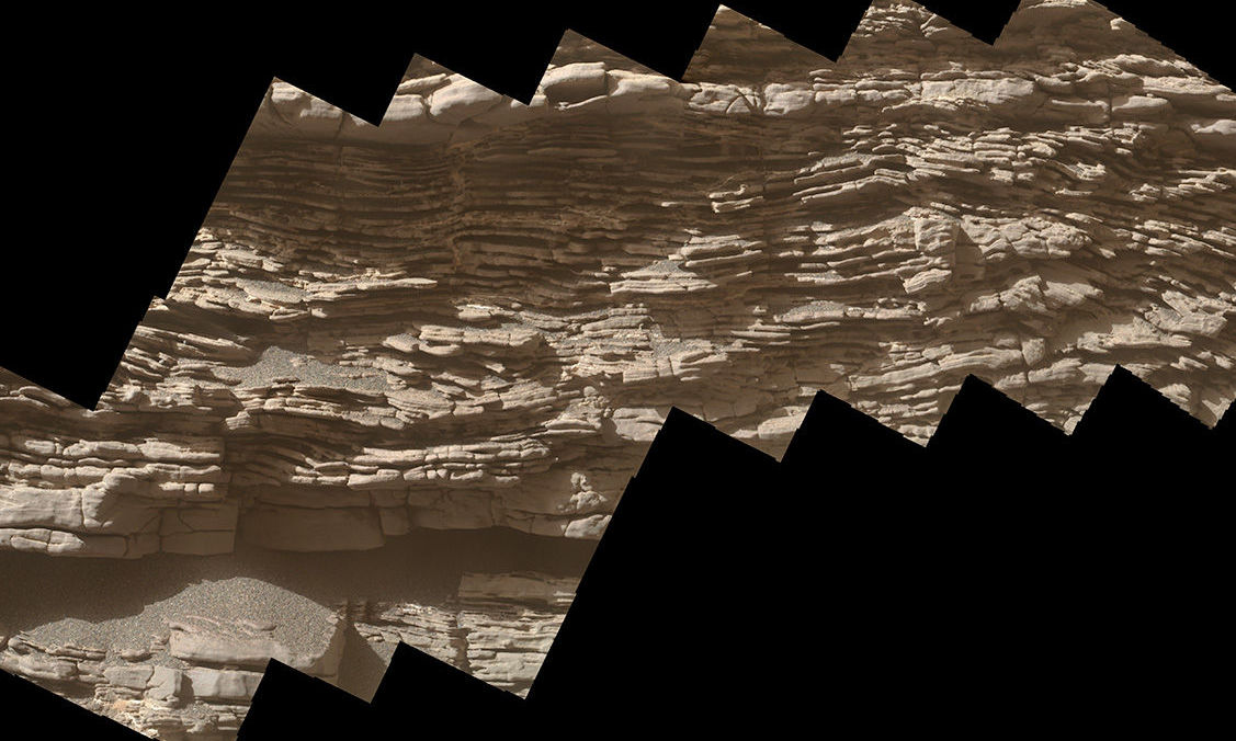 This mosaic of images shows layers of sediment on a boulder-sized rock called Strathdon, as seen by the Mars Hand Lens Imager (MAHLI) camera carried by NASA's Curiosity rover. The images were taken on July 10, 2019, the 2,462nd Martian day, or sol, of the mission.