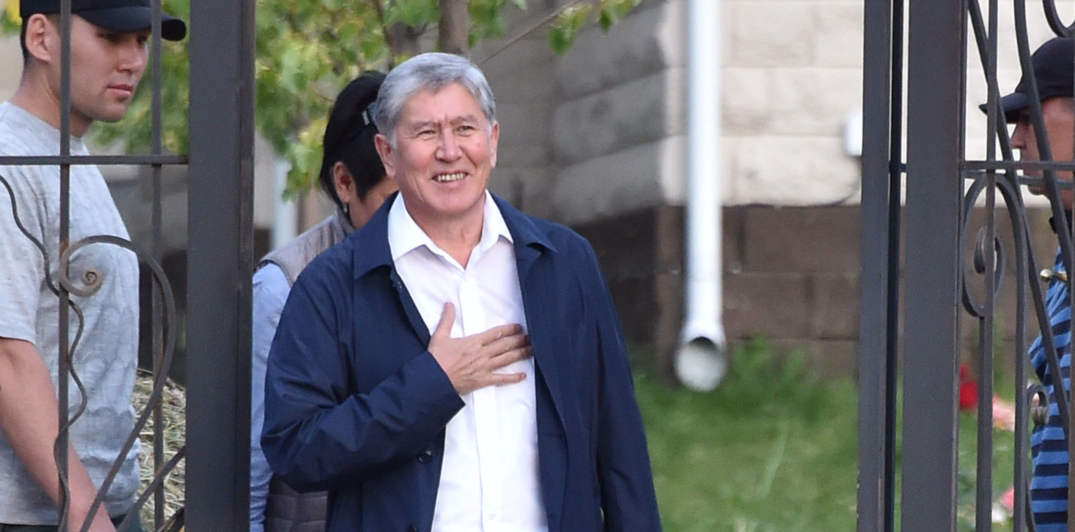 In this file photo taken on June 27, 2019 Former Kyrgyz president Almazbek Atambayev stands at the entrance to his residence in the village of Koi-Tash near the capital Bishkek
