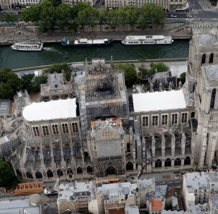 A view shows the damaged roof of Notre-Dame de Paris during restoration work, three months after a fire that devastated the cathedral in Paris