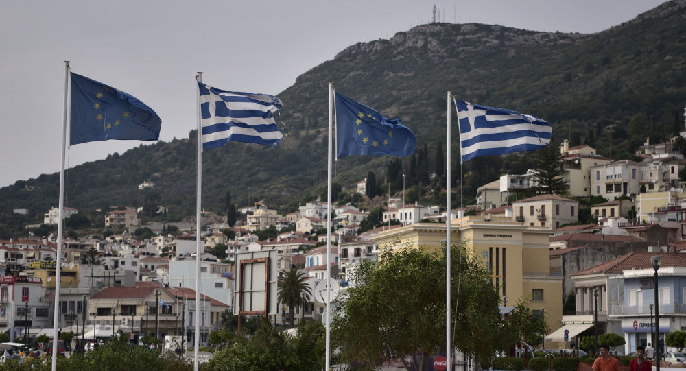 Greek and EU flags in the city of Vathy on the island of Samos, June 2019