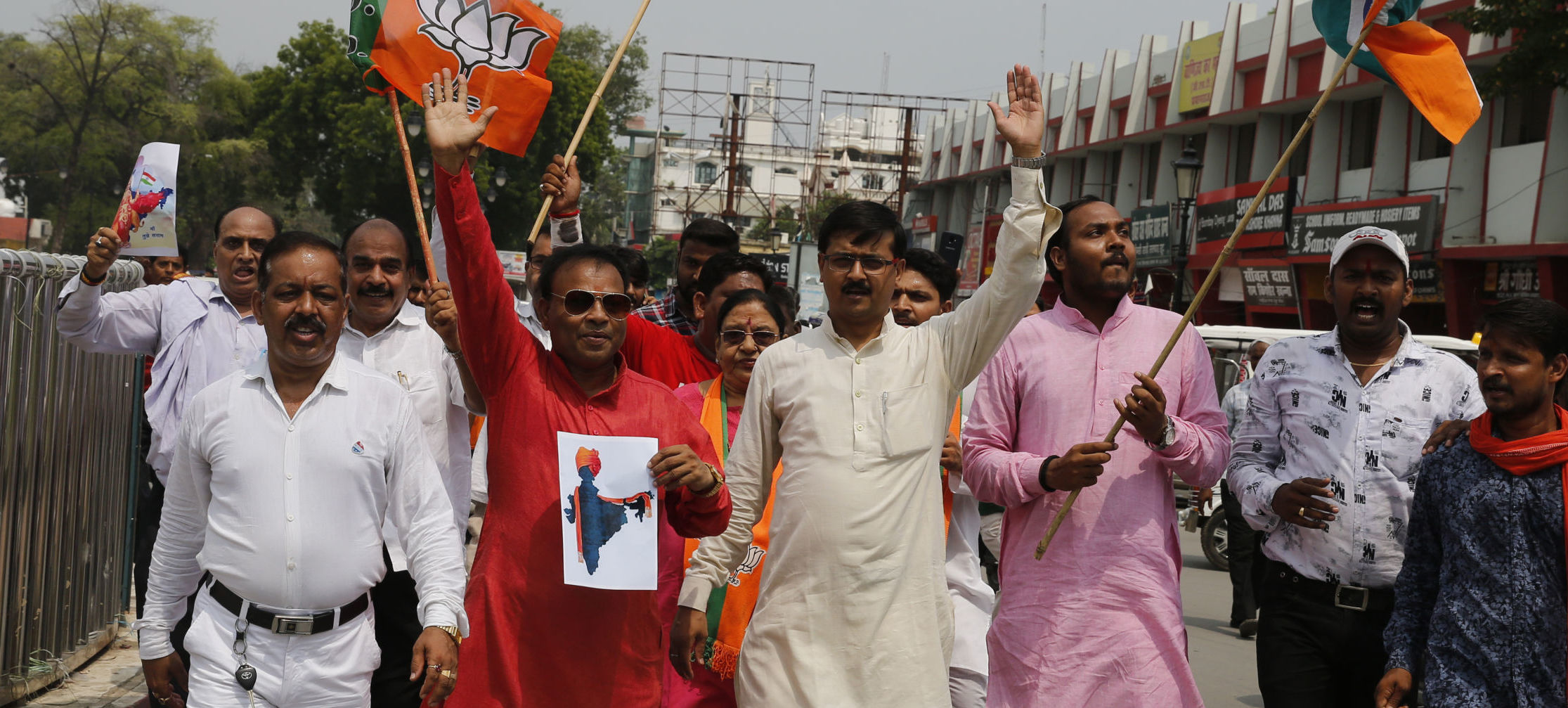 India's ruling Bharatiya Janata Party (BJP) supporters celebrate government revoking disputed Kashmir's special status in Prayagraj, India, Monday, Aug. 5, 2019