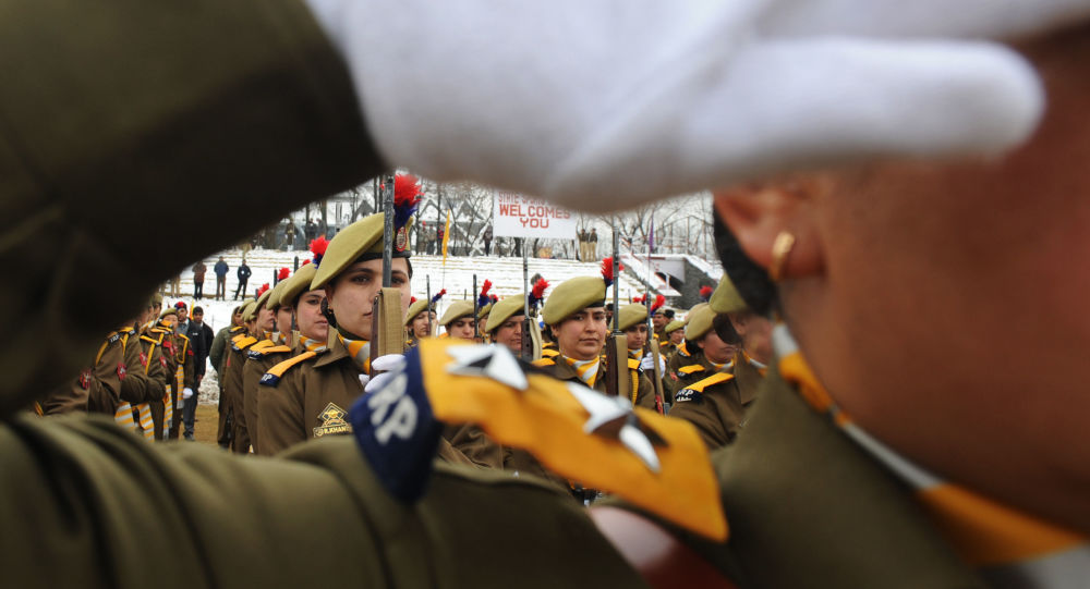 An Indian policewoman looks on while participating in a rehearsal for the upcoming 65th Republic Day in Srinagar on January 24, 2014