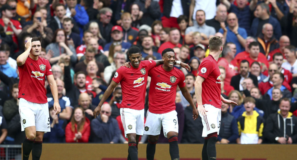 Manchester United's Anthony Martial, 2nd right, celebrates with teammates after scoring his sides second goal during the English Premier League soccer match between Manchester United and Chelsea at Old Trafford in Manchester, England, Sunday, Aug. 11, 2019