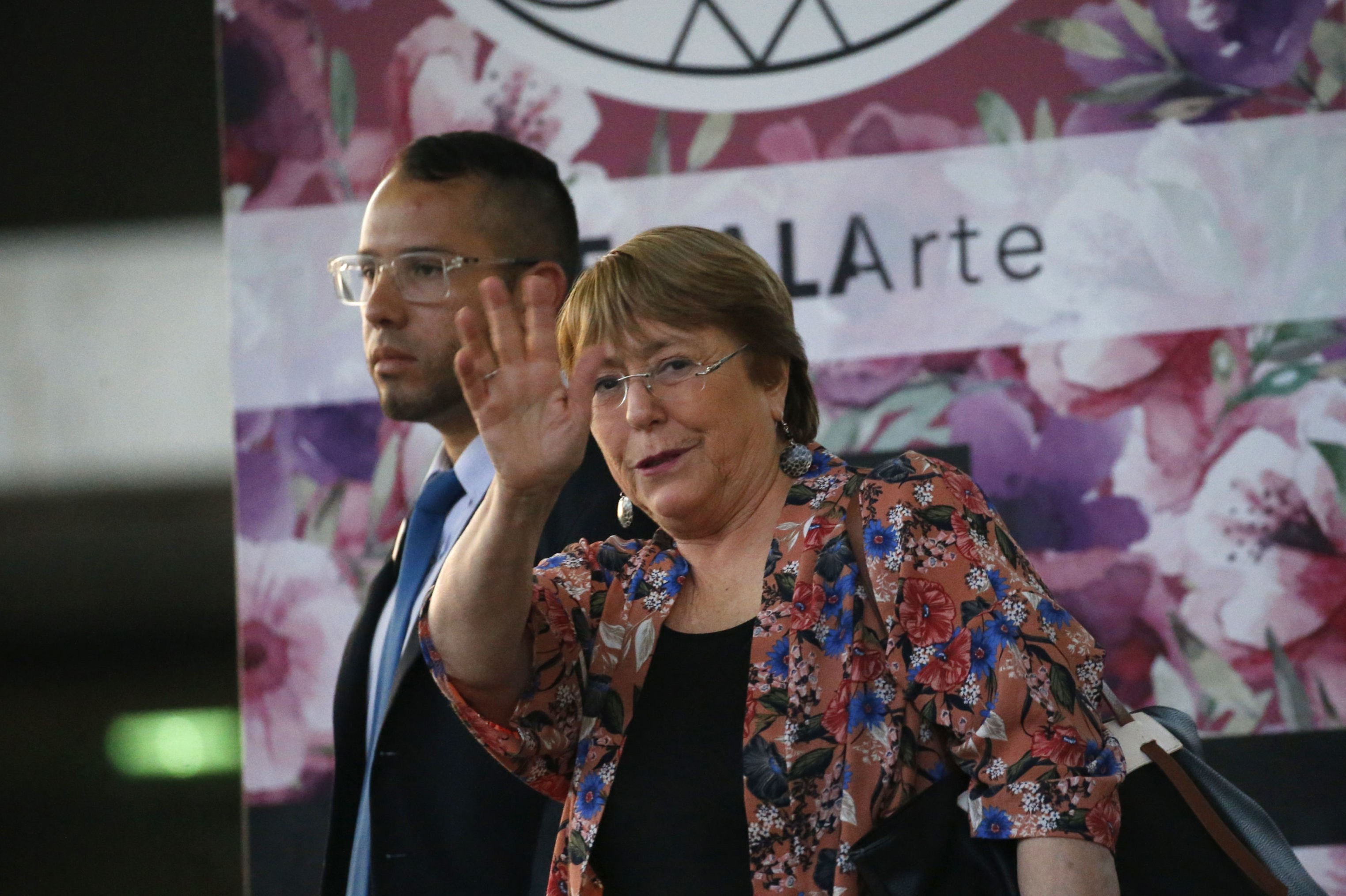 U.N. High Commissioner for Human Rights Michelle Bachelet waves as she exits the Simon Bolivar International Airport in Maiquetia, Venezuela
