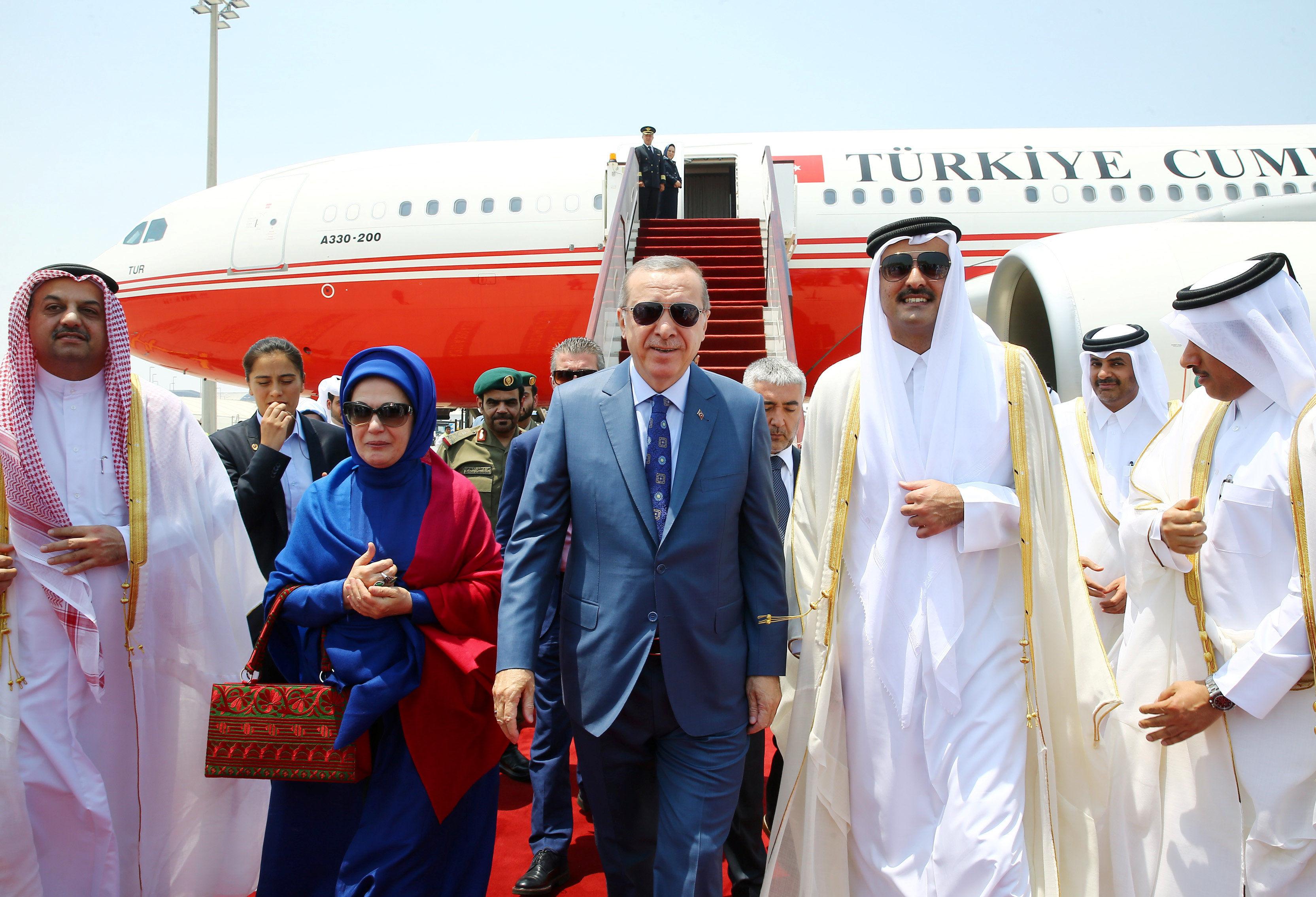 Turkish President Tayyip Erdogan, accompanied by his wife Emine Erdogan, is welcomed by Emir of Qatar Sheikh Tamim Bin Hamad Al-Thani in Doha, Qatar, July 24, 2017.