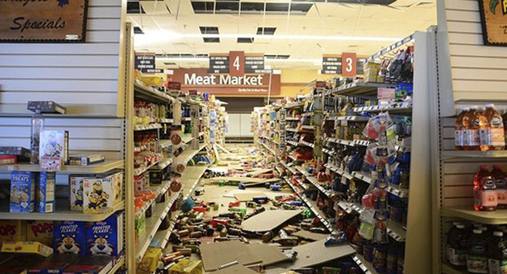 This July 7, 2019 photo provided by the U.S. Navy shows damage to a store at the Naval Air Weapons Station China Lake military base following series of earthquakes on July 4 and 5. The base sustained heavy damage that experts estimate will cost over $5 billion to repair. (Mass Communication Specialist John Scorza/U.S. Navy via AP)