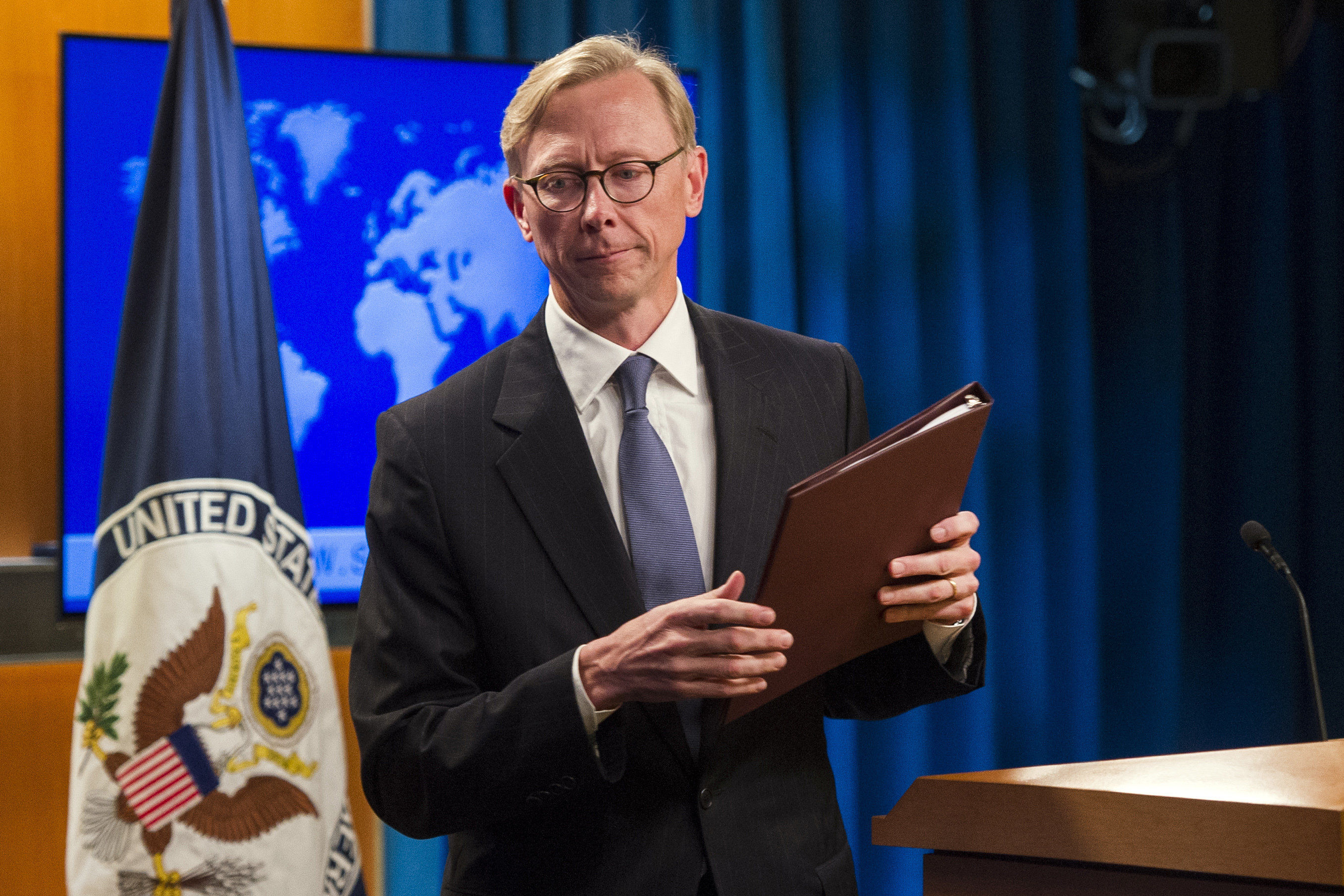 Brian Hook, special representative for Iran, leaves the podium after speaking about the creation of the Iran Action Group at the State Department, in Washington, Thursday, Aug. 16, 2018