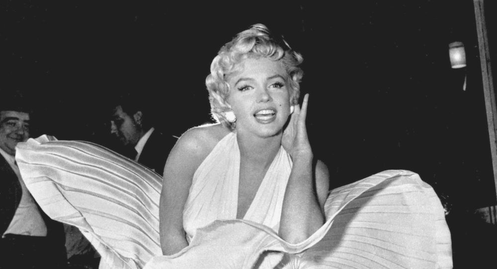 Marilyn Monroe poses over the updraft of New York subway grating while in character for the filming of The Seven Year Itch in Manhattan on September 15, 1954