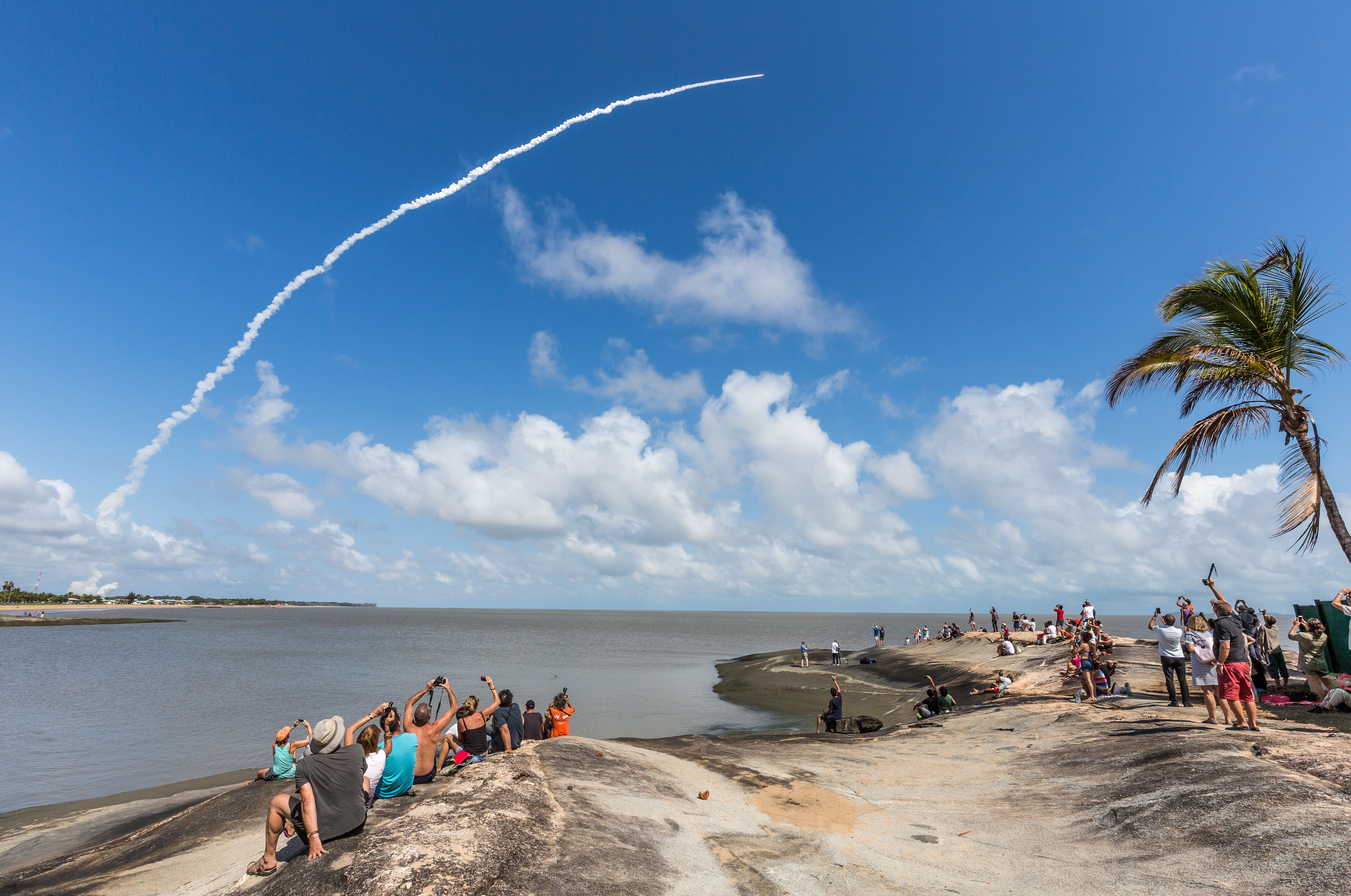 People take photos as an Ariane 5 space rocket with a payload of four Galileo satellites lifts off from ESA's European Spaceport in Kourou, French Guiana, on November 17, 2016