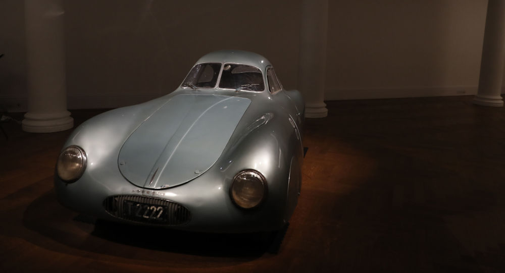 A 1939 Porsche Type 64, the oldest car to wear a Porsche badge and the personal car of German car designer and manufacturer Ferdinand and Ferry Porsche on display during a press preview at Sotheby's auction house in London, Tuesday, May 21, 2019. This is the only surviving example of the Type 64 Porsche which is a direct ancestor of the iconic Porsche 365. The car will go on sale at an auction in Monterey Ca. in August and is expected to sell at around 15.75 million pounds sterling, (US$ 20 million, euro 18 million). (AP Photo/Alastair Grant)