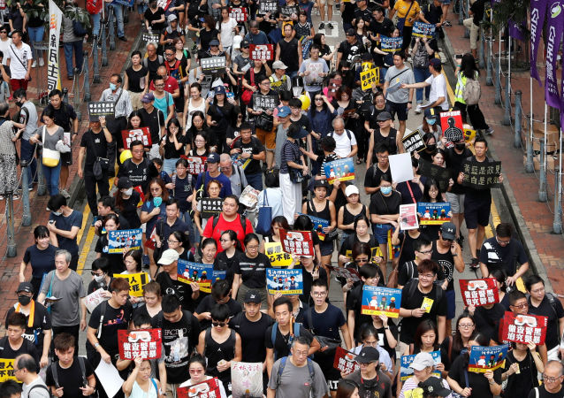 Anti-extradition bill protesters march to demand democracy and political reforms, in Hong Kong, China August 18, 2019. REUTERS/Tyrone Siu