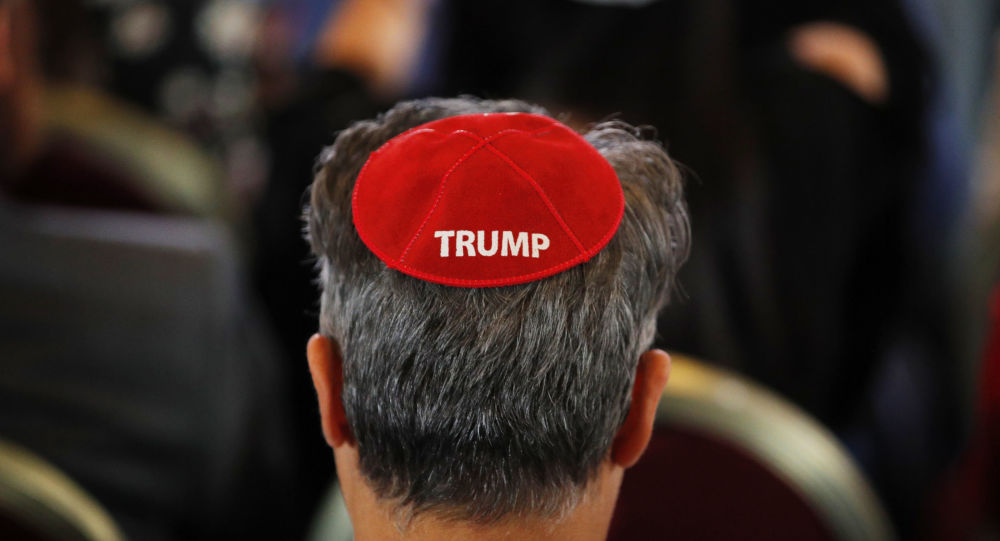 An attendee wears a yarmulke with the word Trump before President Donald Trump speaks at an annual meeting of the Republican Jewish Coalition