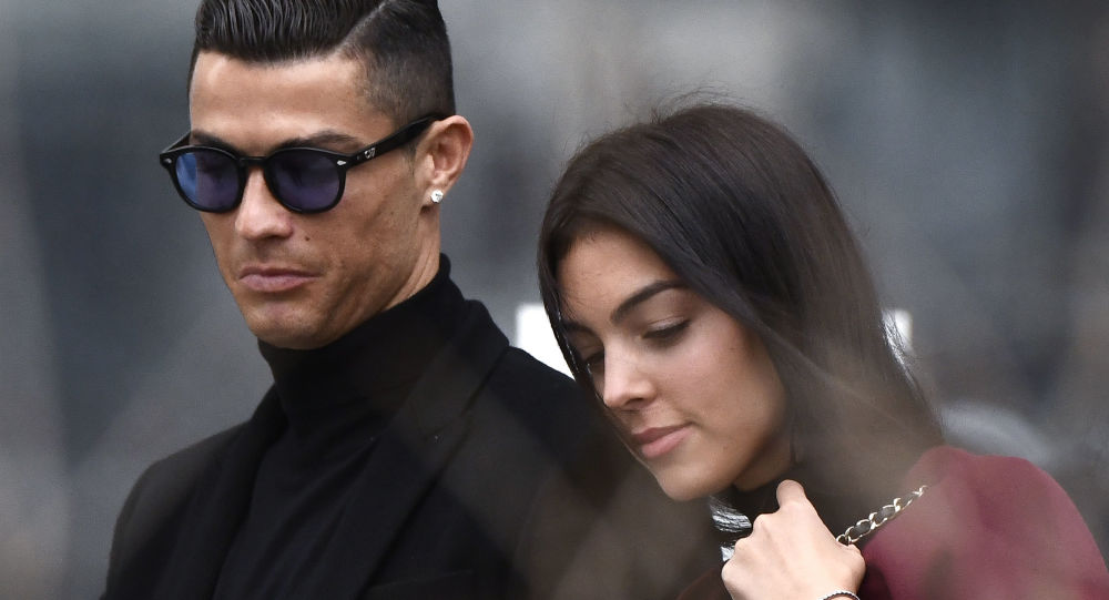 Juventus' forward and former Real Madrid player Cristiano Ronaldo leaves with his Spanish girlfriend Georgina Rodriguez after attending a court hearing for tax evasion in Madrid on January 22, 2019.