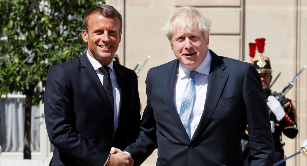 French President Emmanuel Macron welcomes British Prime Minister Boris Johnson before a meeting on Brexit at the Elysee Palace in Paris, France, August 22, 2019