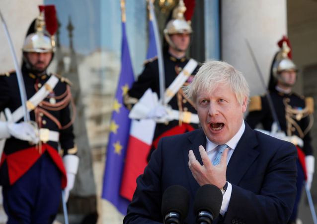 British Prime Minister Boris Johnson delivers a joint statement with French President Emmanuel Macron (not seen) before a meeting on Brexit at the Elysee Palace in Paris, France, August 22, 2019