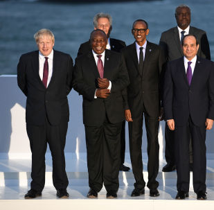 Britain's Prime Minister Boris Johnson, South African President Cyril Ramaphosa, Rwanda's President Paul Kagame, Egypt's President Abdel-Fattah el-Sisi, Japan's Prime Minister Shinzo Abe, pose for a family photo at the G7 summit in Biarritz, France