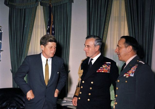 President John F. Kennedy meets with Chief of the Defense Staff of the British Armed Forces Lord Louis Mountbatten, First Earl Mountbatten of Burma (center) and Chairman of the Joint Chiefs of Staff General Lyman Lemnitzer (right) in the Oval Office, White House, Washington, D.C.