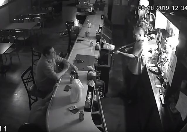 World's Chillest Man Lights Cigarette at Gunpoint During Bar Robbery