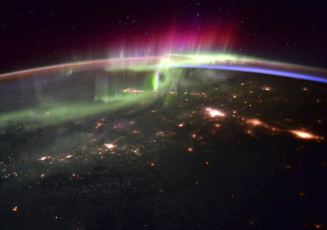 The dancing lights of the Aurora Borealis is shown over the Pacific northwest taken from the International Space Station