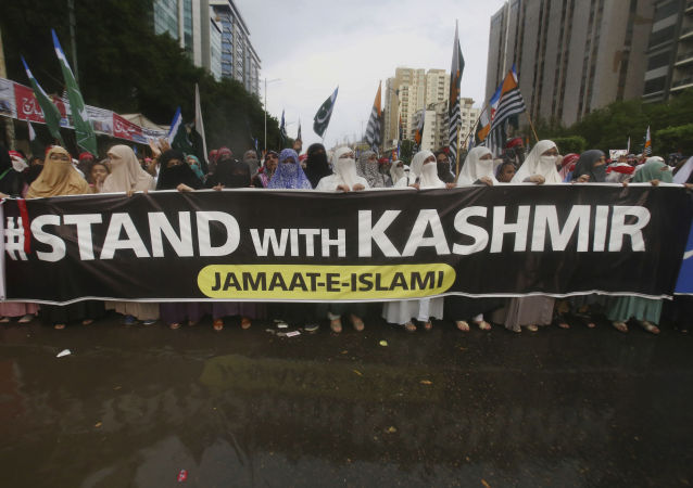 Supporters of a Pakistani religious party take part in a rally to express solidarity with Indian Kashmiris, in Karachi, Pakistan, Sunday, Sept. 1, 2019