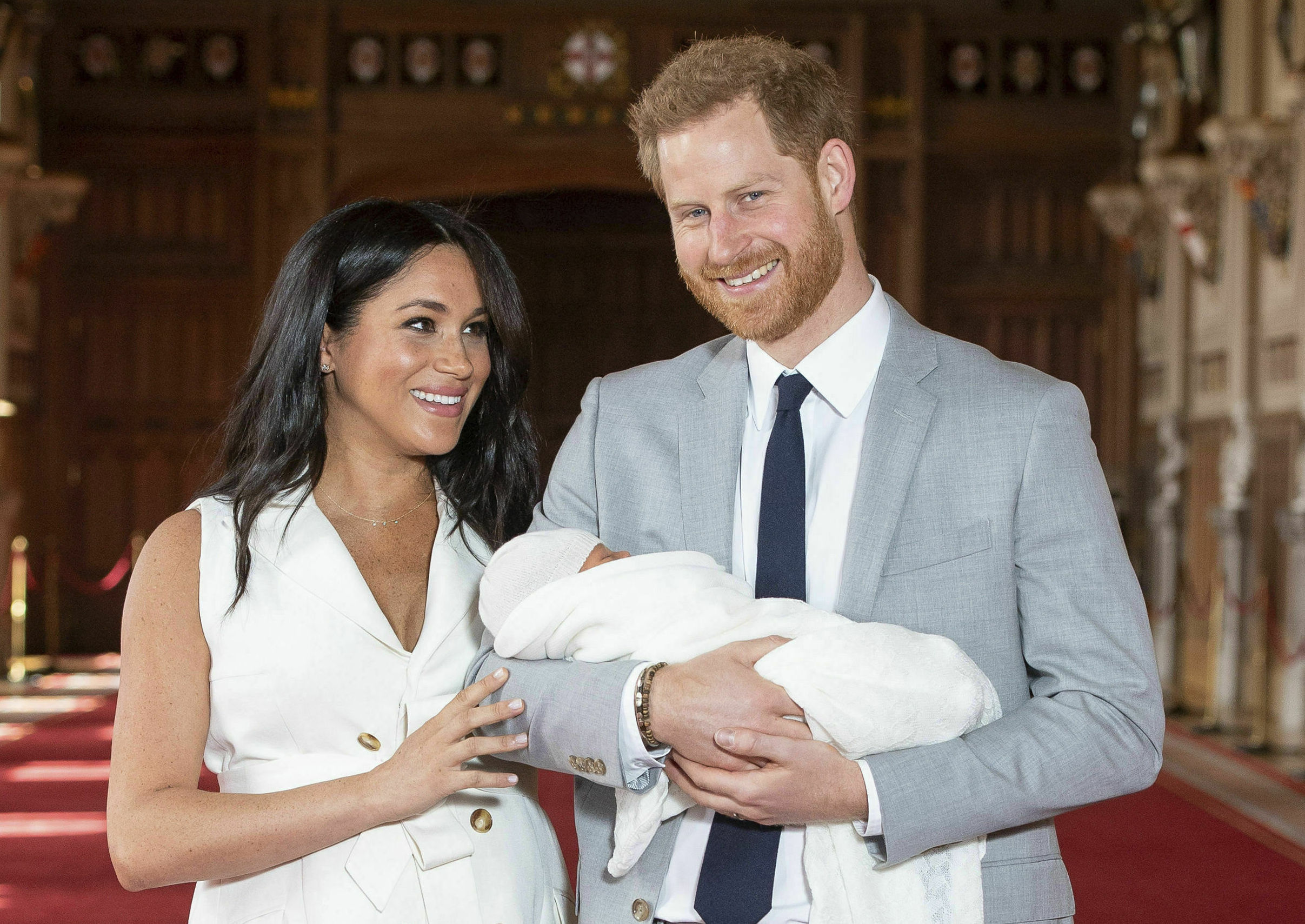 Britain's Prince Harry and Meghan, Duchess of Sussex, during a photocall with their newborn son, in St George's Hall at Windsor Castle, Windsor, south England, Wednesday May 8, 2019